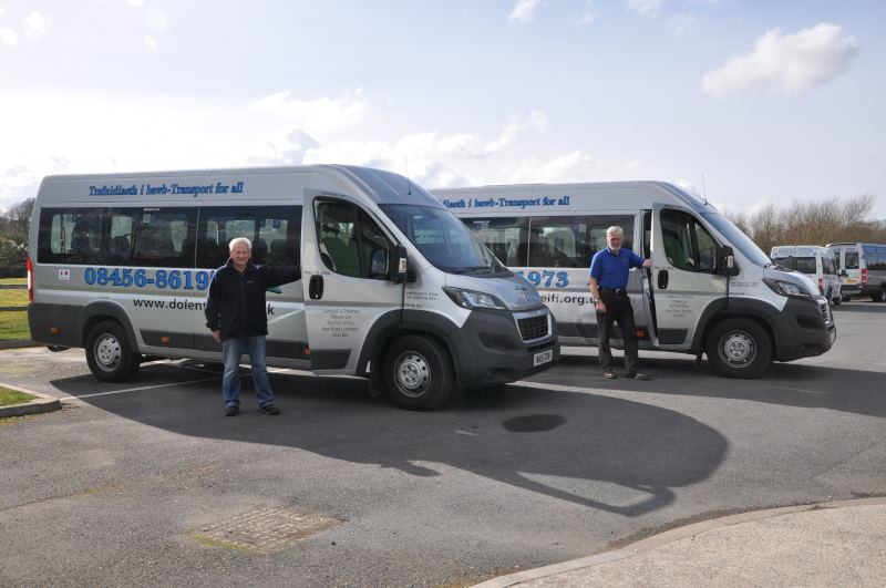Two Silver Dolen Teifi minbuses with volunteer drivers.
